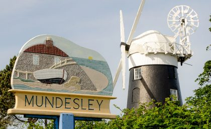 Mundesley Village sign and Stow Mill, Norfolk